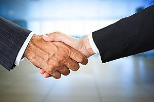 a bankruptcy debtor shaking hands with a buyer after developing a successful negotiation strategy between him and the buyer
