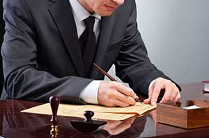 Litigation Attorney writing notes from statutes of limitations on debt case